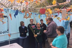 Community gathering in the sukkah